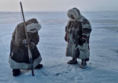 Seyakha Nenets ice fishing with a spear