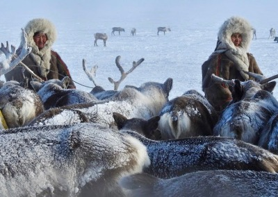 Seyakha Nenets women wearing traditional women's hats made of reindeer fur and lined with Arctic fox fur